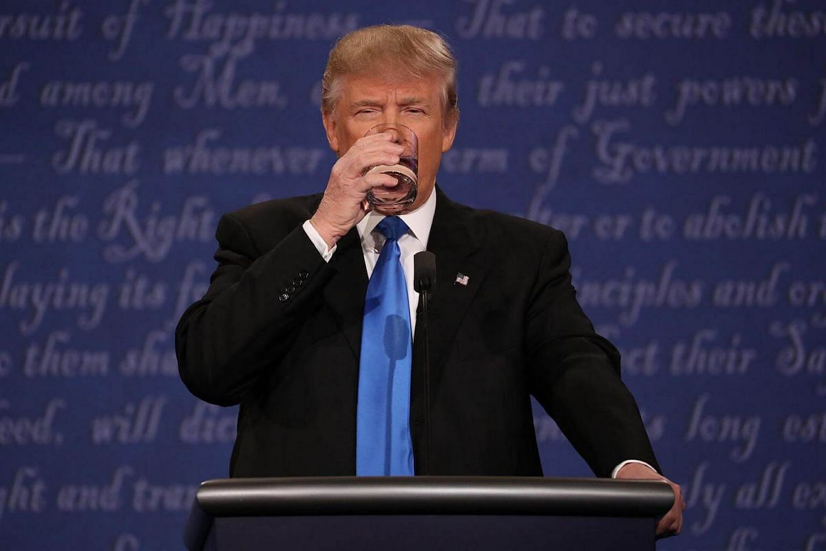 Mr Donald Trump takes a drink of water during the first presidential debate at Hofstra University in Hempstead, New York, on Sept 26, 2016.