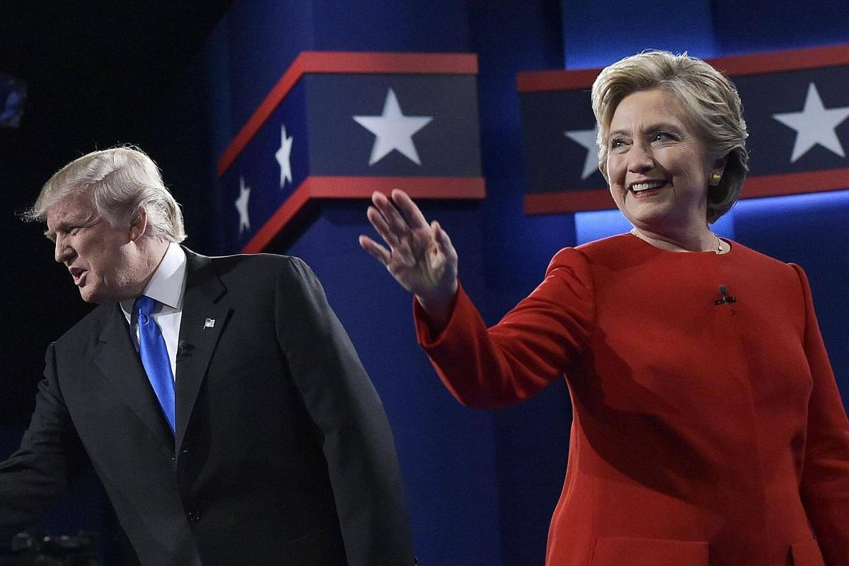 Republican nominee Donald Trump and Democratic nominee Hillary Clinton arrive on stage for the first presidential debate at Hofstra University in Hempstead, New York on Sept 26, 2016.