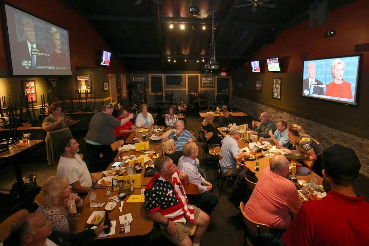 A group of Trump supporters watch the first televised debate between Republican presidential candidate Donald Trump and Democratic candidate Hillary Clinton at a restaurant in Medina Ohio, a suburb of Cleveland, Ohio, on Sept 26, 2016.