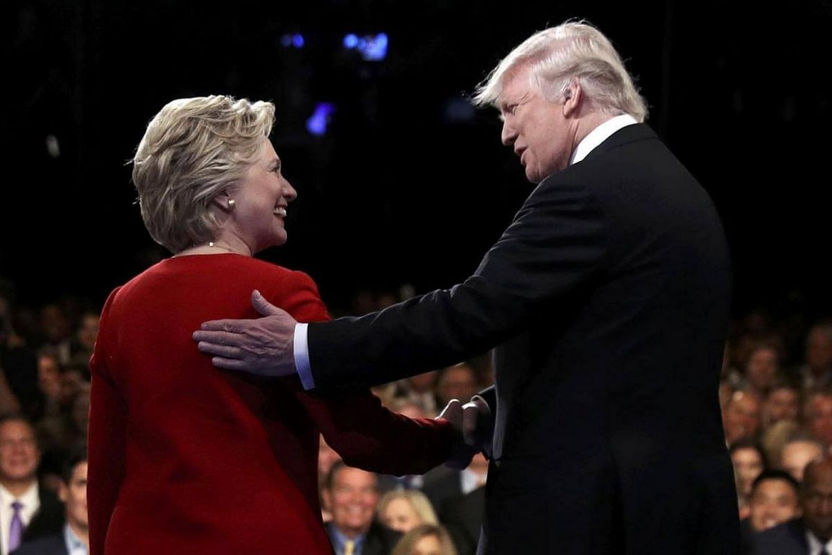 Republican nominee Donald Trump with Democratic nominee Hillary Clinton at the start of their first presidential debate at Hofstra University in Hempstead, New York, on Sept 26, 2016.