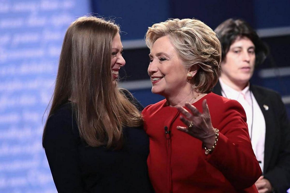 Democratic presidential nominee Hillary Clinton (right) talks with daughter, Chelsea Clinton (left) after the Presidential Debate with Republican presidential nominee Donald Trump at Hofstra University on Sept 26, 2016 in Hempstead, New York.