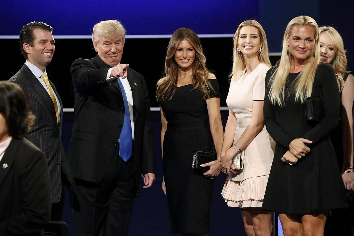 Republican US presidential nominee Donald Trump (second left) stands with Trump family members after the first presidential debate at Hofstra University in Hempstead, New York, US, Sept 26, 2016.
