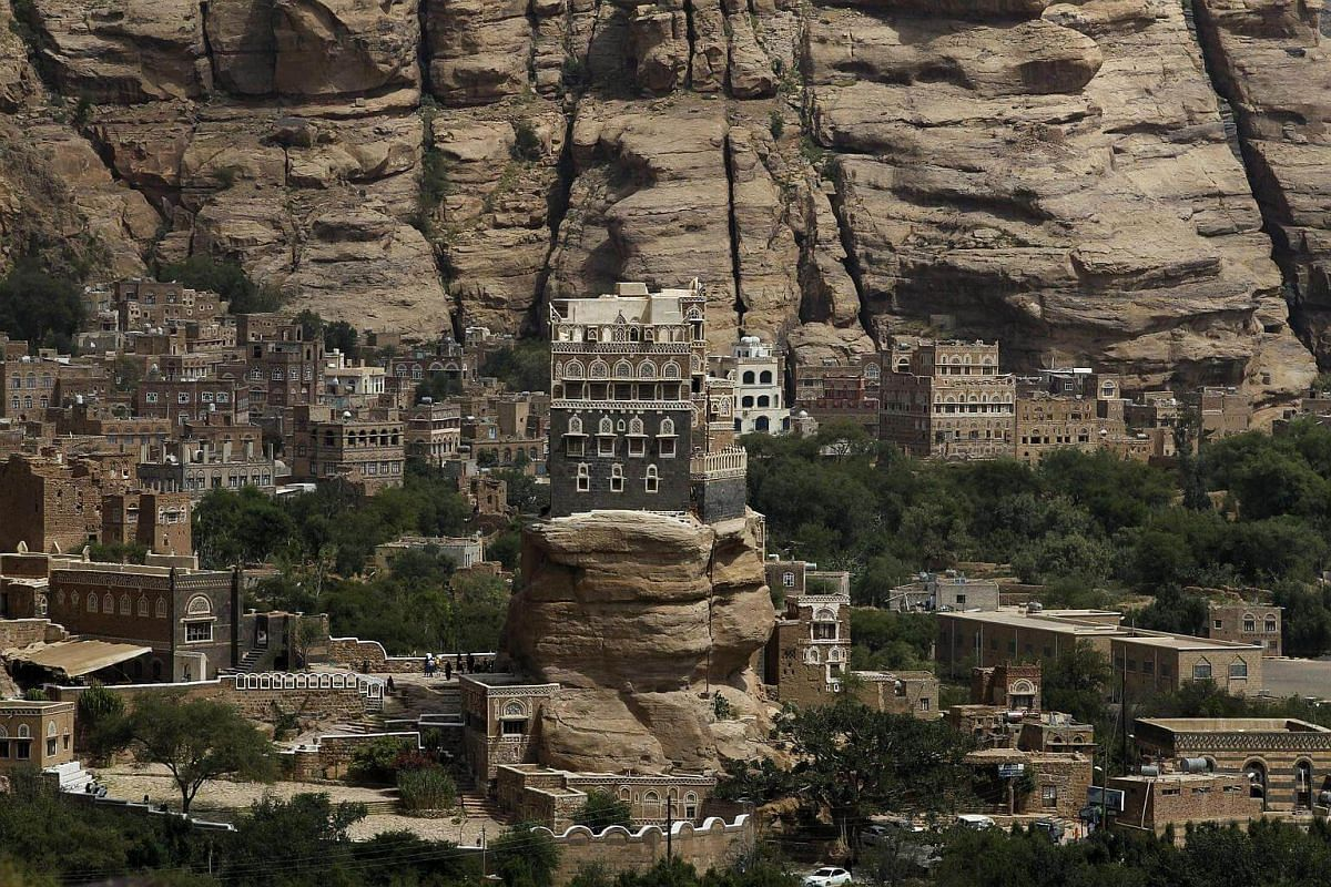 The Dar al-Hajar (Rock Palace) is perched atop a rock pinnacle, at the Wadi Dhahr valley in Sana'a, Yemen, on Sept 26, 2016.