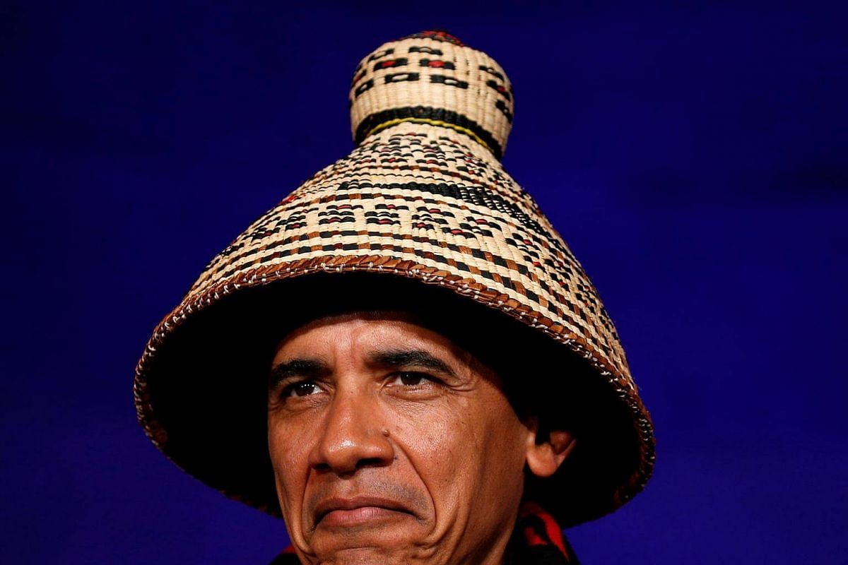 US President Barack Obama looks up as he is honored during a traditional blanketing ceremony at the White House Tribal Nations Conference in Washington on Sept 26, 2016.