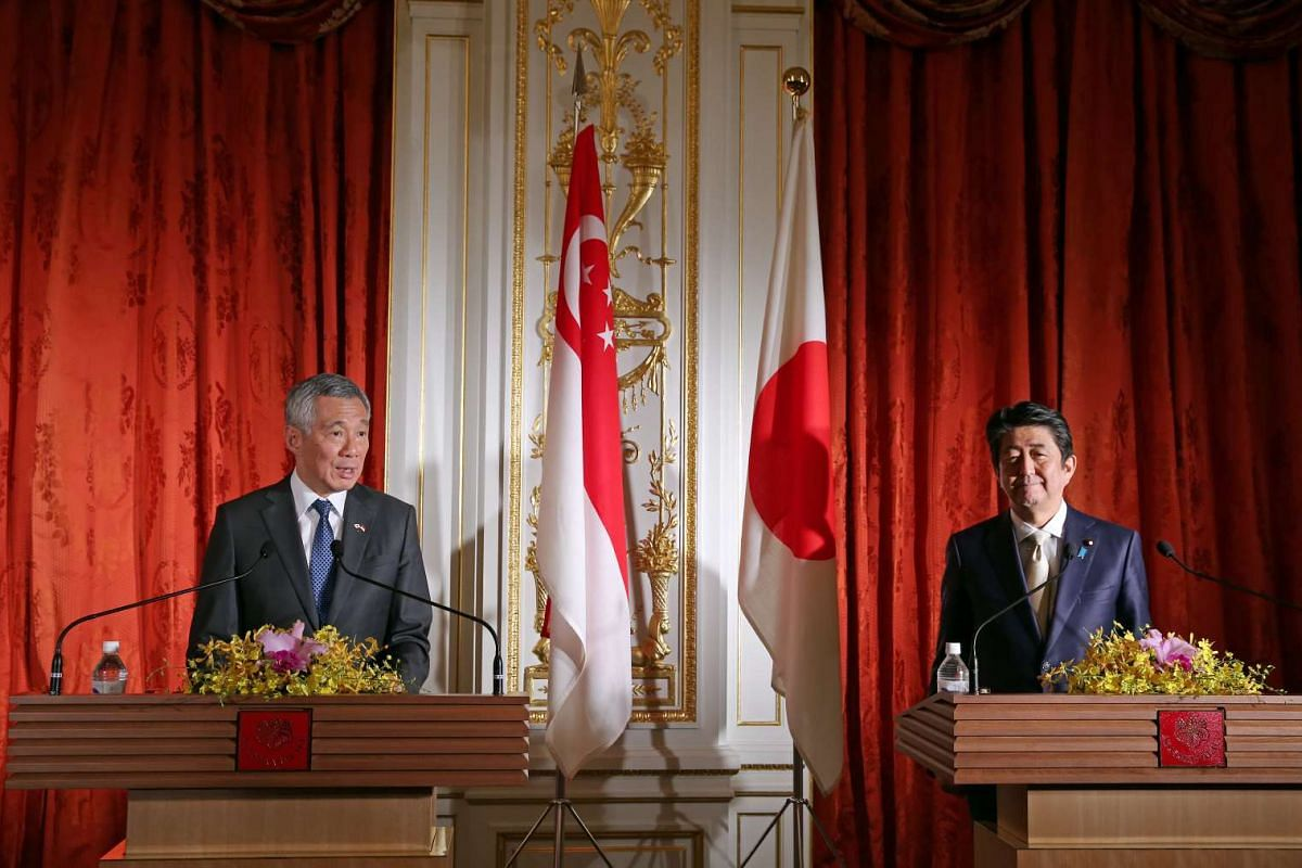 Singapore Prime Minister Lee Hsien Loong and Japanese Prime Minister Shinzo Abe give their remarks to the press at Sairan no Ma, Akasaka State Guest House, on Sept 28, 2016.
