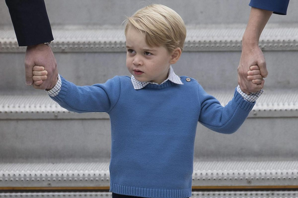 Britain's Prince George arrives with his parents at Victoria Airport in Victoria, British Columbia, Canada, on Sept 24.