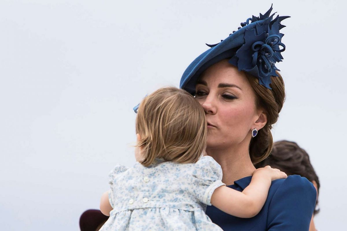 Britain's Catherine, Duchess of Cambridge, kisses Princess Charlotte as they arrive at Victoria Airport in Victoria, British Columbia, Canada, on Sept 24.