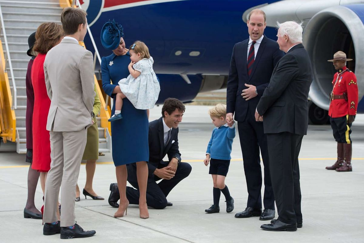Canadian Prime Minister Justin Trudeau kneels to talk to Prince George as his father Prince William speaks to Governor General David Johnston (right) on Sept 24.