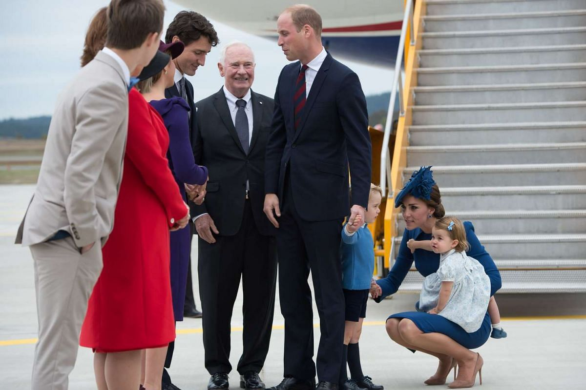 Prime Minister Justin Trudeau greets Prince William, Catherine, the Duchess of Cambridge, and their children Prince George and Princess Charlotte at Victoria Airport in Victoria, British Columbia, Canada, on Sept 24.