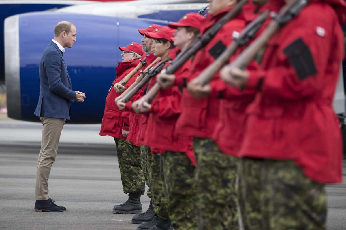 Britain's Prince William, Duke of Cambridge, inspects Canadian Rangers after arriving at Whitehorse Airport, Yukon, Canada, on Sept 27.