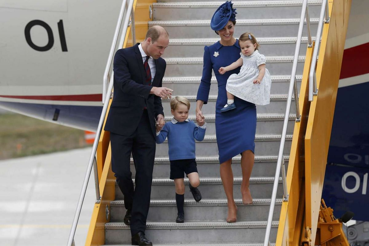 Britain's Prince William, Catherine, Duchess of Cambridge, Prince George and Princess Charlotte arrive at Victoria Airport, Victoria, British Columbia, Canada on Sept 24.
