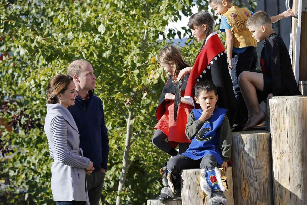 Britain's Prince William and Catherine, Duchess of Cambridge, with aboriginal children after a presentation during a ceremony in Carcross, Yukon, Canada, on Sept 28.