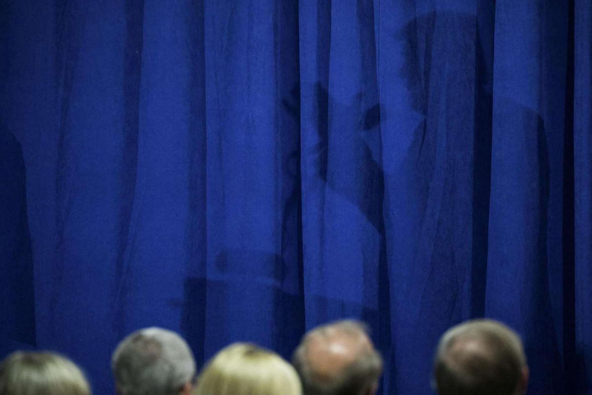 The shadow of Donald Trump is seen on a curtain as he speaks at a campaign event at the Polish National Alliance in Chicago on Sept 28, 2016.
