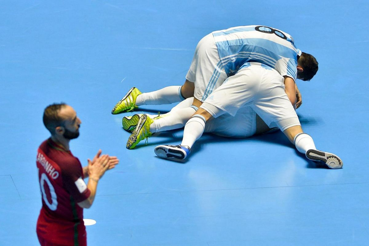 Argentina's team players celebrate after scoring against Portugal during their Colombia 2016 FIFA Futsal World Cup match at the Coliseo El Pueblo stadium, in Cali, Colombia on Sept 28, 2016.
