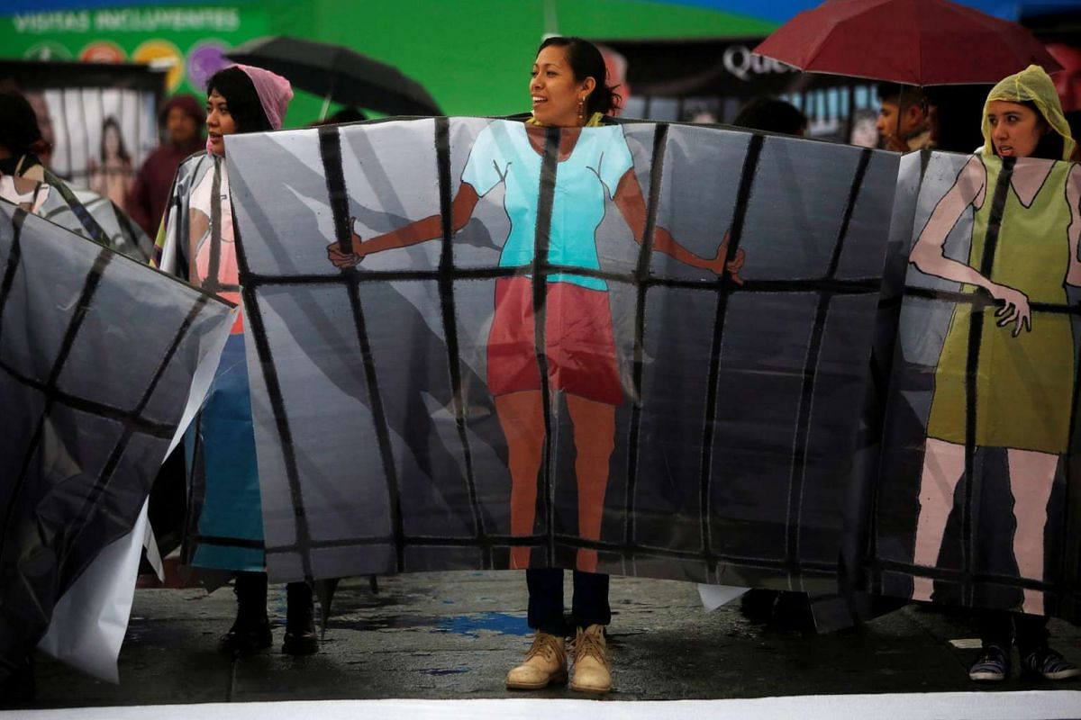 A pro-abortion activist wearing a poncho with an illustration of a woman in jail, demonstrates to demand the decriminalization of abortion in Mexico City, Mexico on Sept 28, 2016.