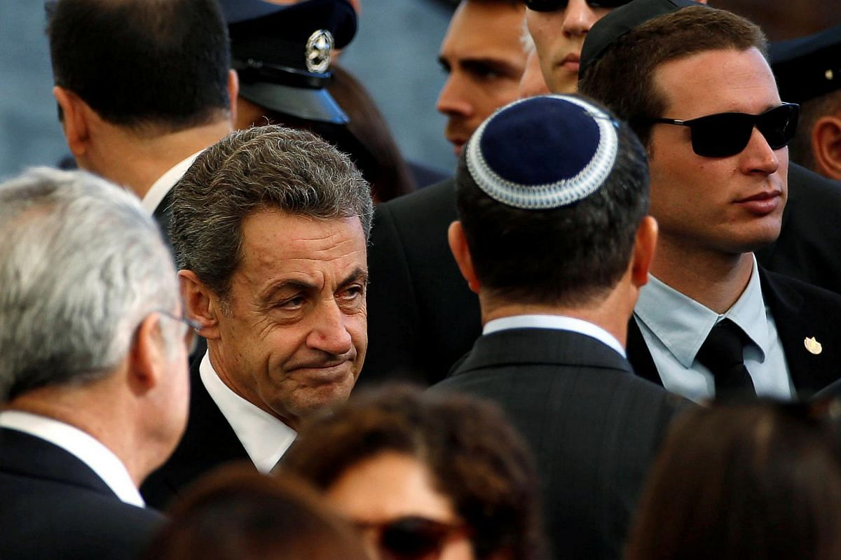 Former French President Nicolas Sarkozy is seen upon his arrival to attend the funeral of former Israeli president Shimon Peres at Jerusalem's Mount Herzl national cemetery on Sept 30, 2016.