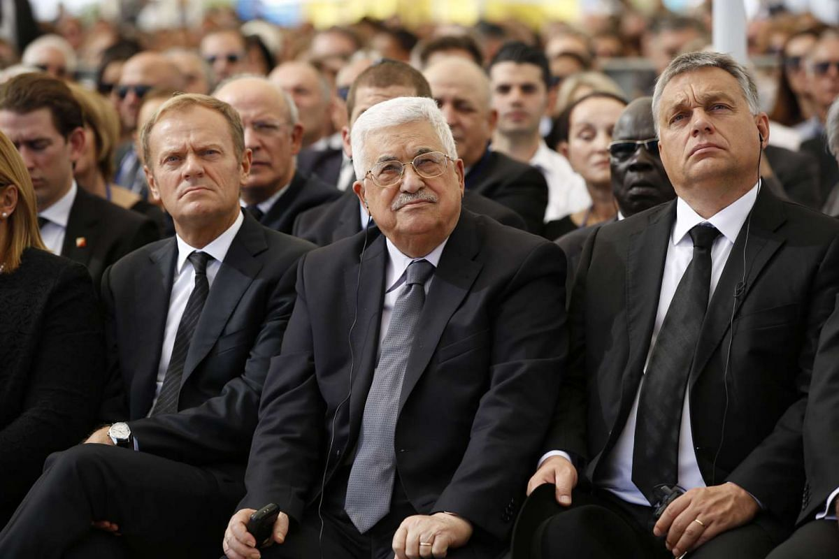 Palestinian president Mahmud Abbas (centre) sits alongside European Council President Donald Tusk (left) and Hungarian Prime Minister Viktor Orban during the funeral of former Israeli president Shimon Peres at the Mount Herzl national cemetery in Jer