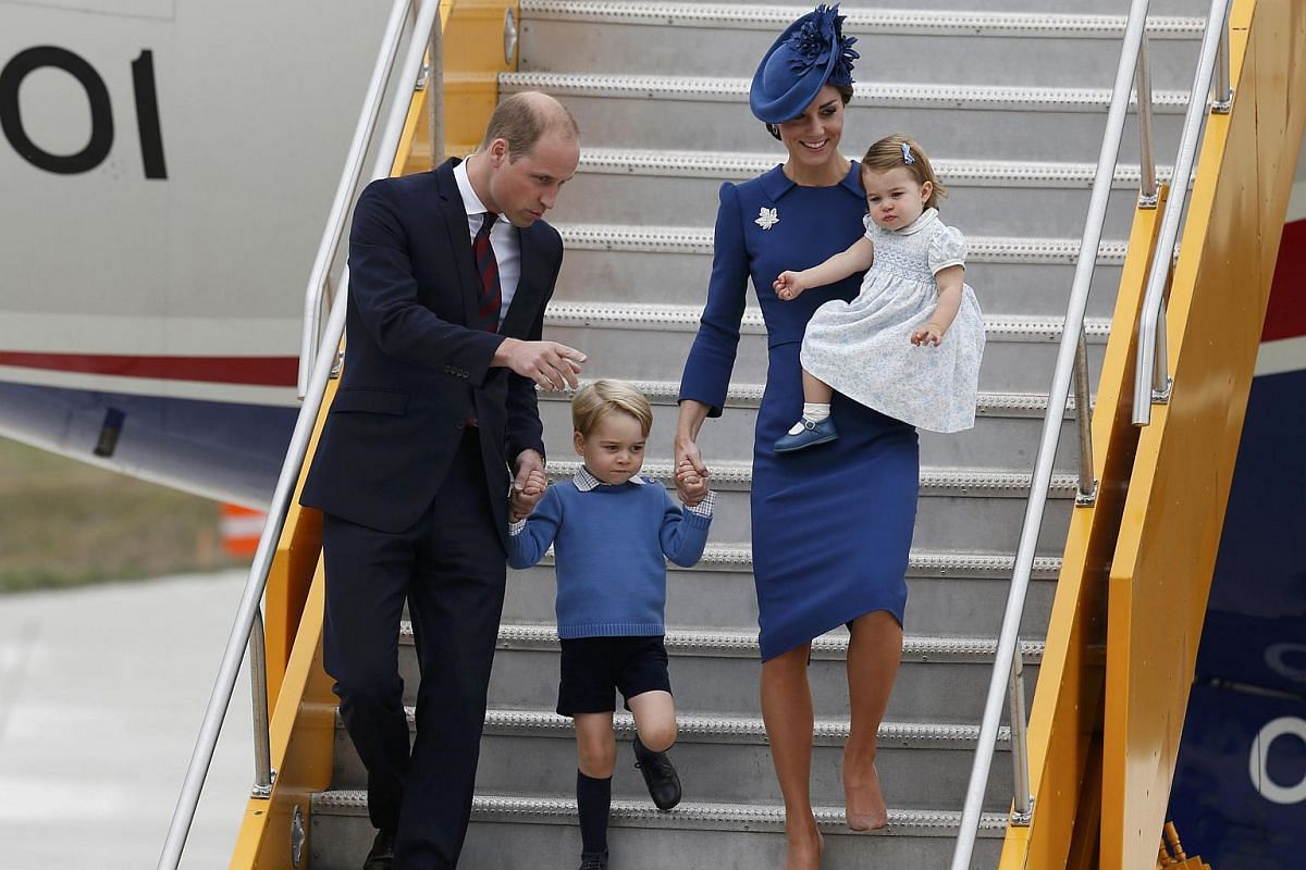 Prince William and his wife Catherine, Duchess of Cambridge arrive at the Victoria International Airport with their children Prince George and Princess Charlotte for the start of their eight day royal tour to Canada on Sept 24, 2016.