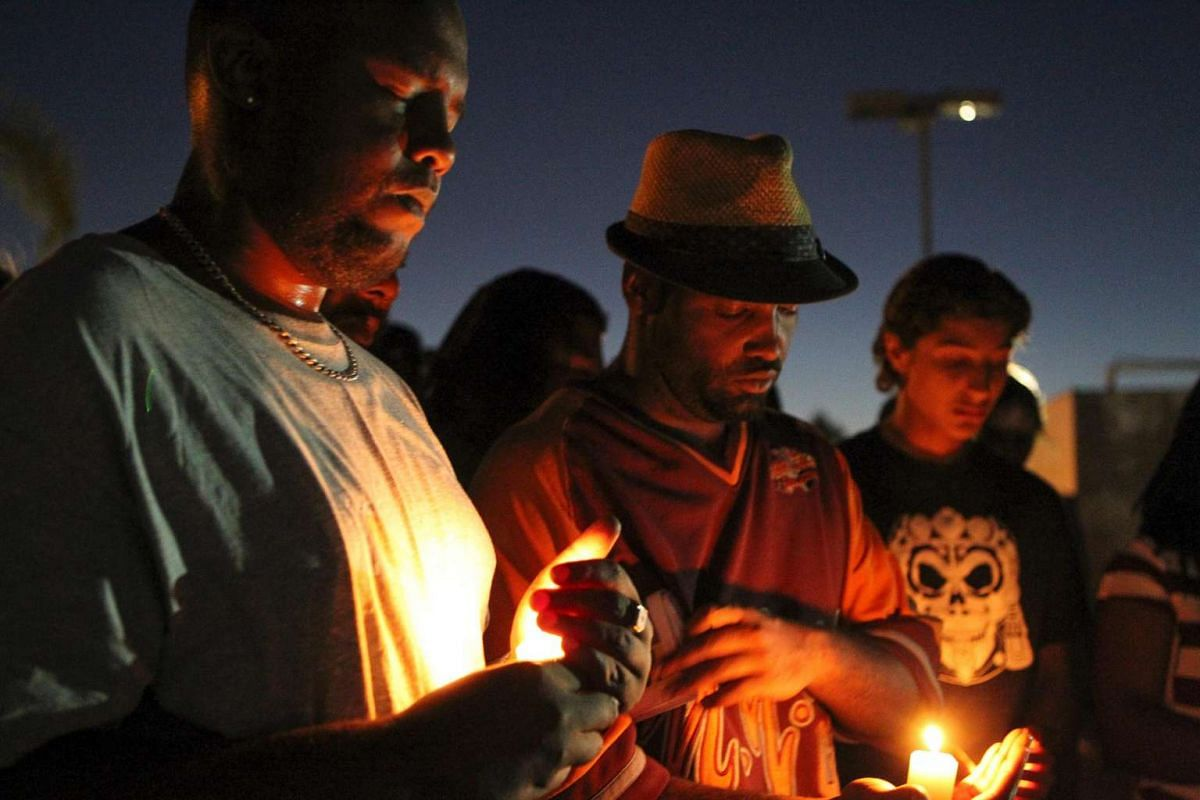 Mourners and activists hold a candle light vigil during a rally in El Cajon, a suburb of San Diego, California on Sept 28, in protest of the police shooting of Alfred Olango the night before.