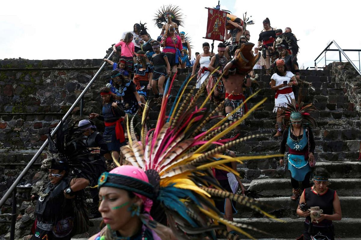 Dancers wearing pre-Hispanic clothing perform a ritual as they protest against the growing of genetically modified corn during National Corn Day celebration at the archeological site of Teotihuacan, Mexico, on Sept 29.