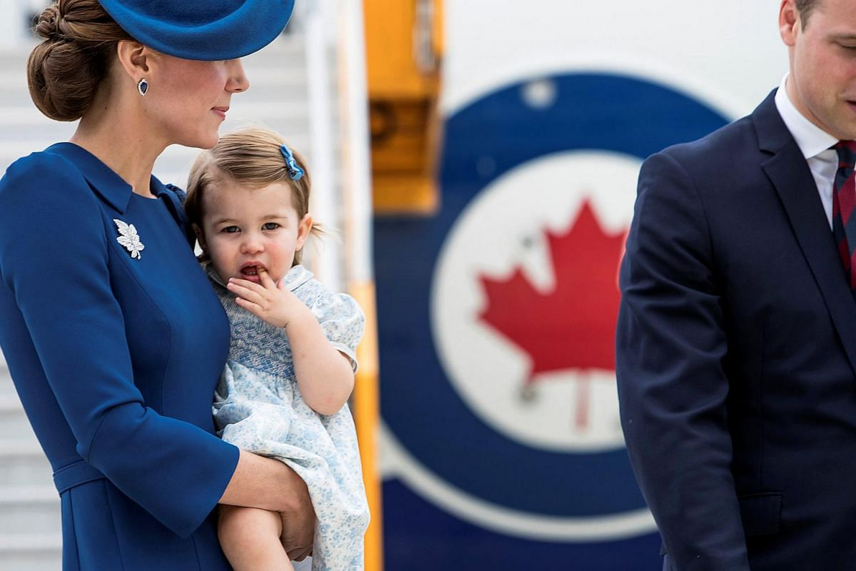 Princess Charlotte is held by her mother Catherine, Duchess of Cambridge as they arrive at the Victoria International Airport on Sept 24, 2016.