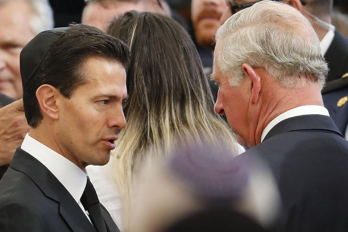 Mexican President Enrique Peña Nieto (left) talks to Britain's Prince Charles during the funeral of former Israeli president Shimon Peres at Jerusalem's Mount Herzl national cemetery on Sept 30, 2016.