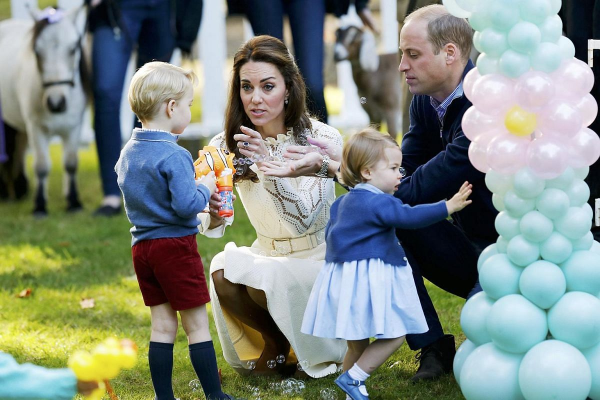Prince William, Catherine, Duchess of Cambridge, Prince George and Princess Charlotte attend a children's party at Government House in Victoria, British Columbia, Canada on Sept 29, 2016.
