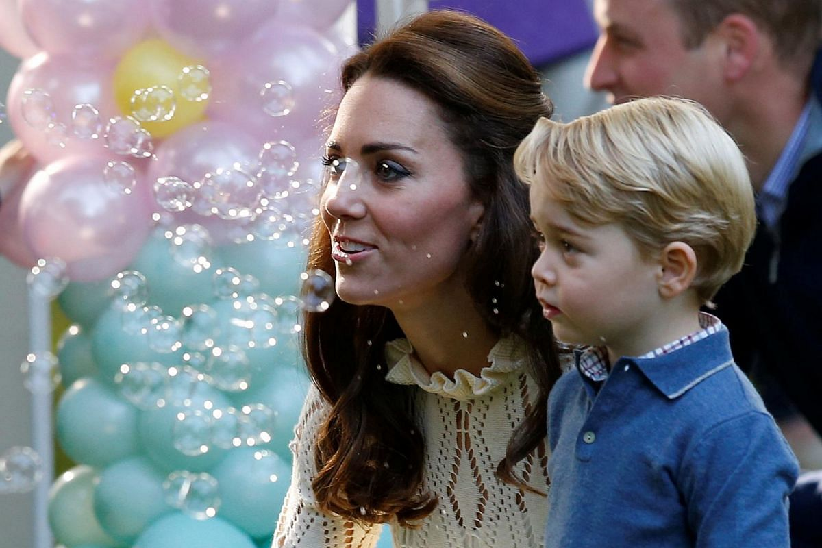 Catherine, Duchess of Cambridge and Prince George look at bubbles at a children's party at Government House in Victoria, British Columbia, Canada on Sept 29, 2016.