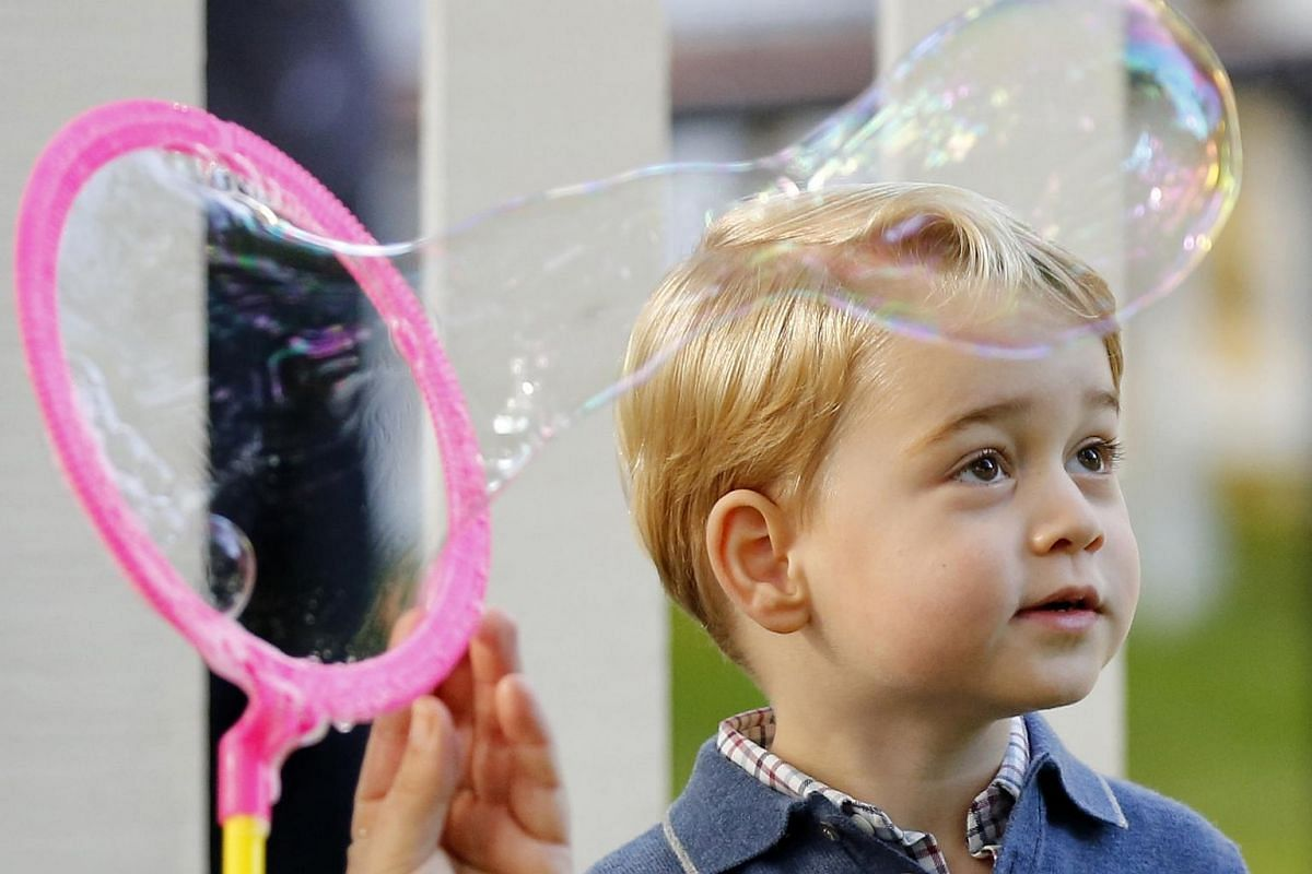 Prince George watches as bubbles are blown at a children's party at Government House in Victoria, British Columbia, Canada on Sept 29, 2016.