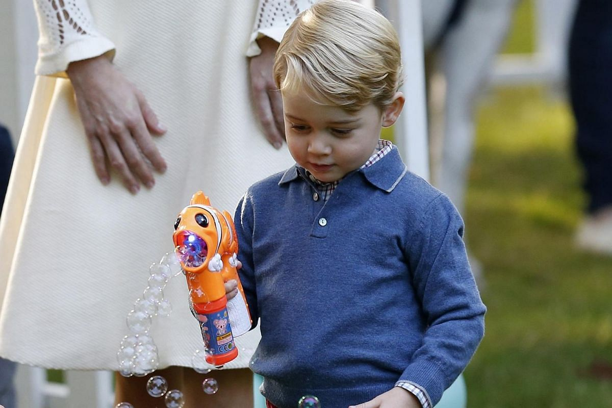 Prince George plays with a bubble gun at a children's party at Government House in Victoria, British Columbia, Canada on Sept 29, 2016.