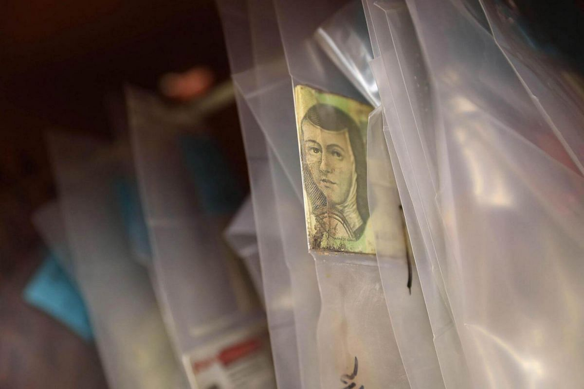 Mexican currency hangs with personal effects of suspected undocumented immigrants are stored at the Office of the Pima County Medical Examiner on Sept 29, 2016 in Tucson, Arizona.