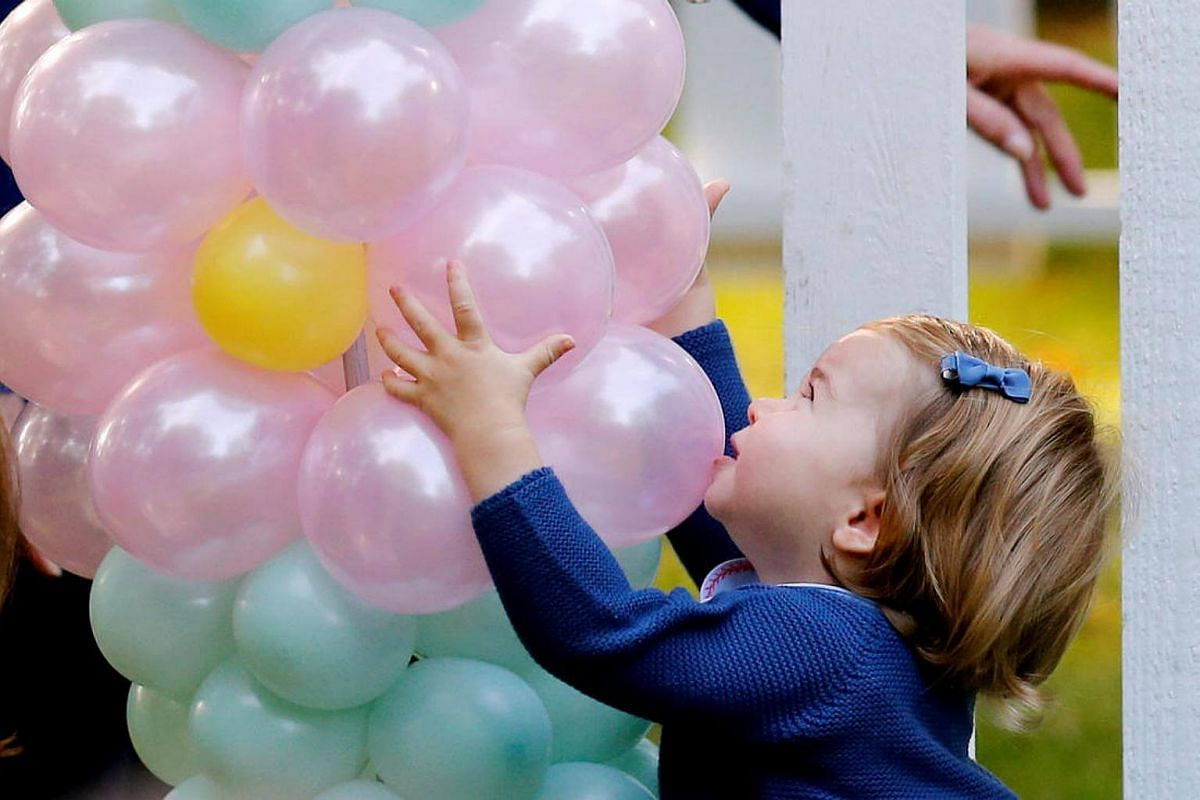 Princess Charlotte plays with balloons during a children's party at Government House in Victoria, British Columbia, Canada, on Sept 29, 2016.