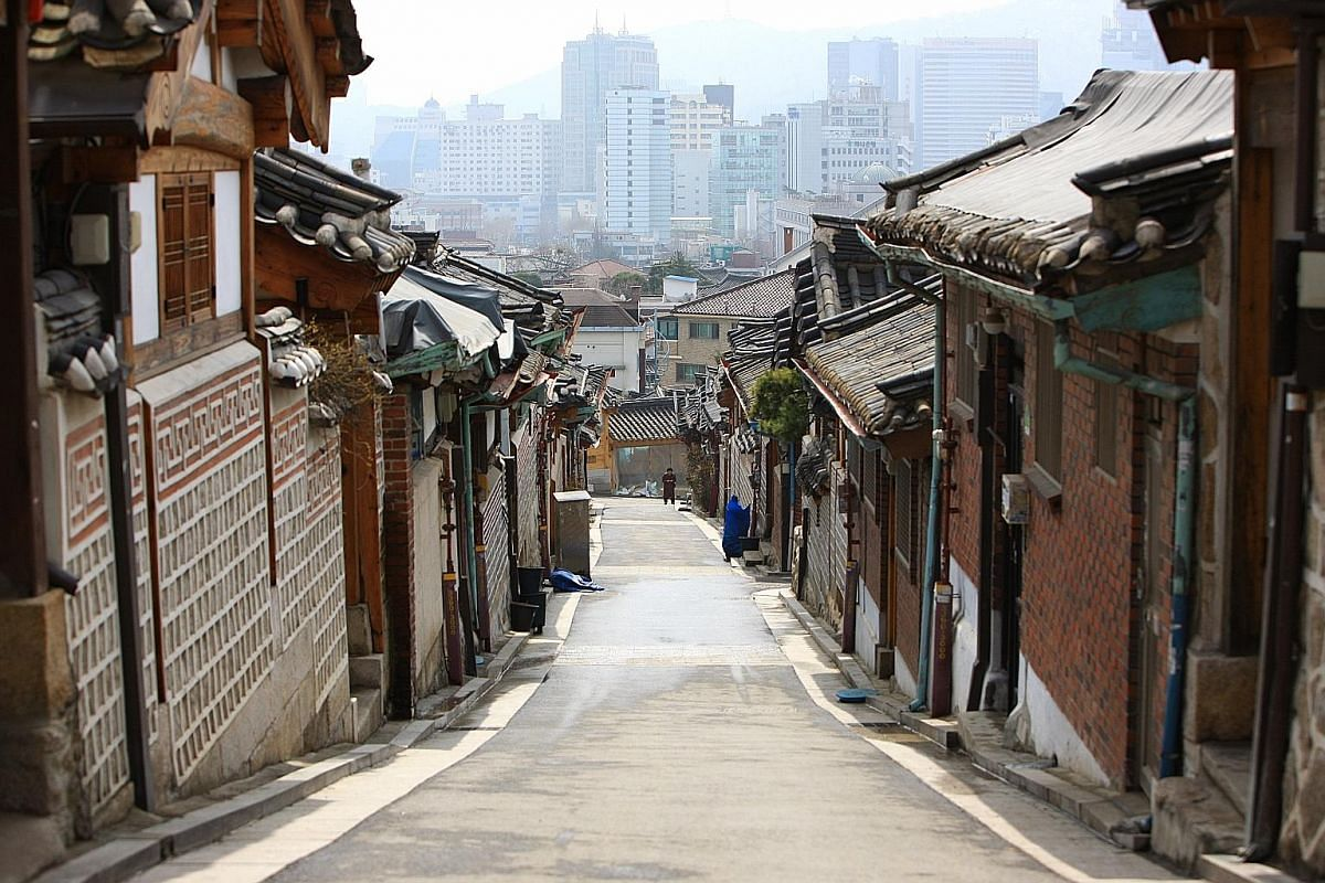 Mr Vincent Ong (above) says the Bukchon Hanok Village (top) allows visitors to see how Koreans used to live.