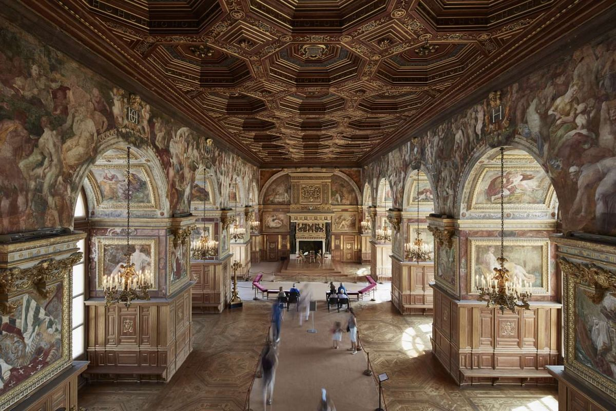 Marvel at the ornate Italian frescoes in the ballroom of the Chateau de Fontainebleau.