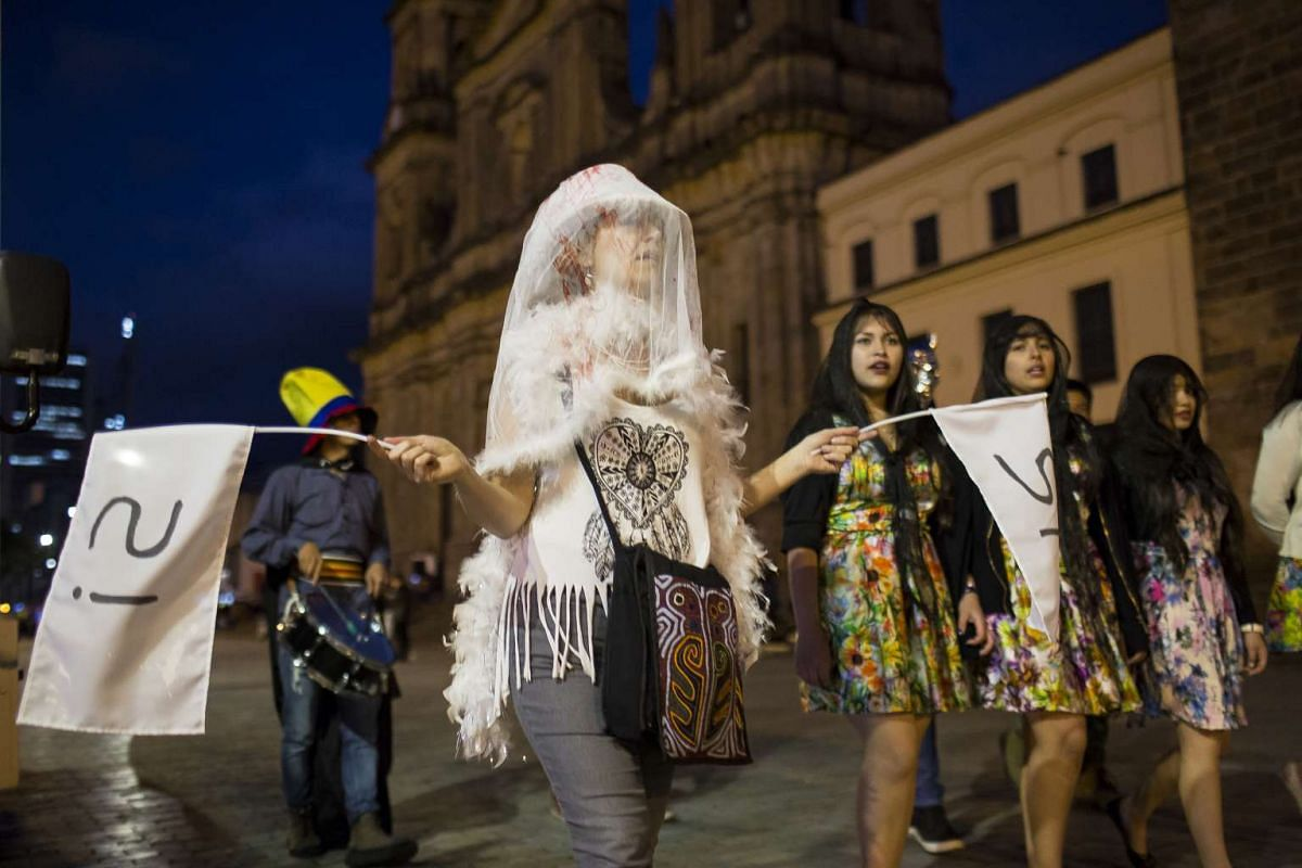 Protesters march in support of the peace deal with the Revolutionary Armed Forces of Colombia (Farc) ahead of the plebiscite in Bogota, Colombia, on Oct 1, 2016. In the end, Colombians voted 'No' to the peace pact signed less than a week ago between