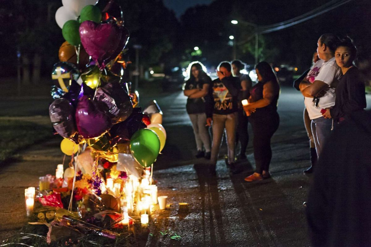 A candlelight memorial for Nisa Mickens, murdered at age 15 along with her friend 16-year-old Kayla Cuevas, in Brentwood, New York, on Sept 16, 2016.