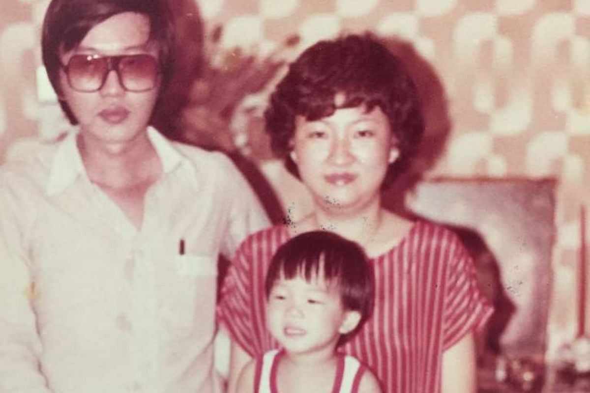 My life so far: Mr Bjorn Low (middle) on his second birthday with his parents Paul Low and Ivy Lim.