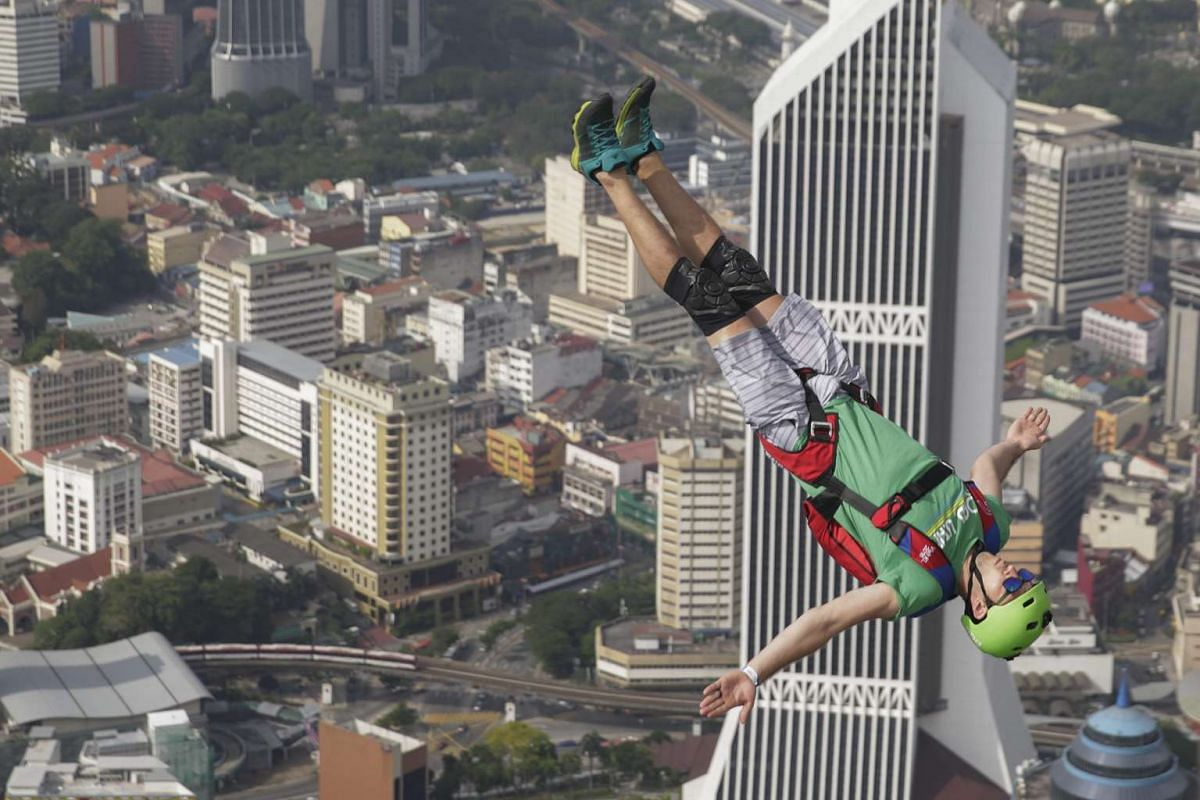 A Base jumper in action against the skyline during the Kuala Lumpur Tower International Jump in Kuala Lumpur, Malaysia, Oct 3, 2016. PHOTO: EPA