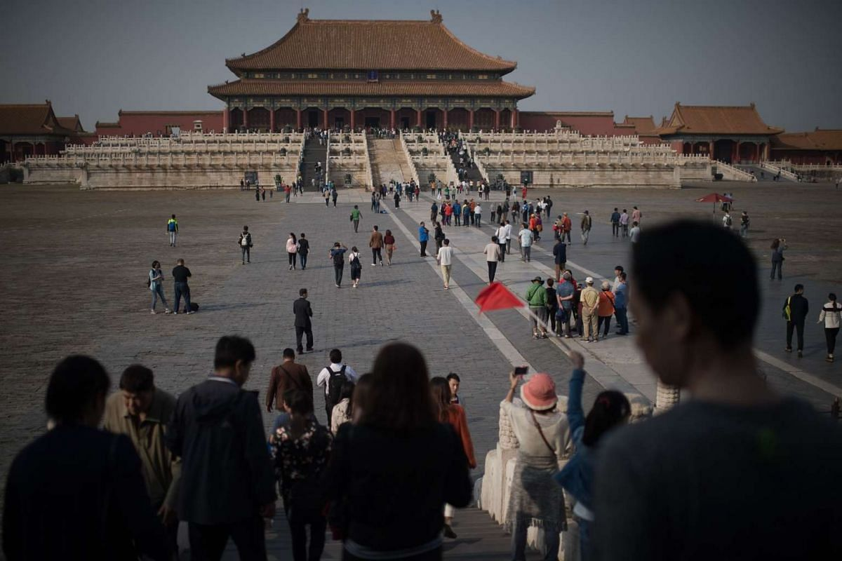 People walk inside the Forbidden City during China's Golden Week holiday in Beijing, on Sept 29, 2016.