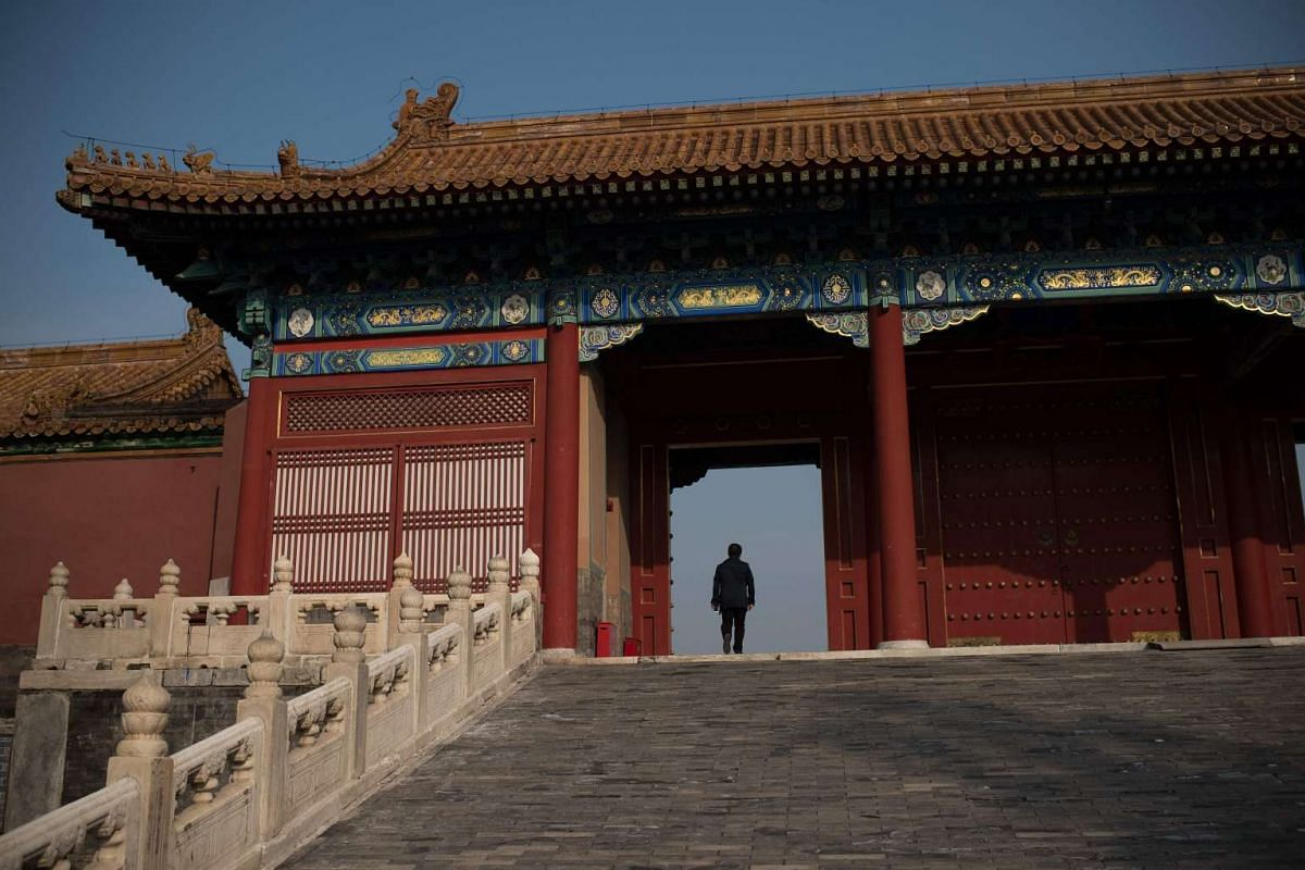 A man walks through a gate inside the Forbidden City during China's Golden Week holiday in Beijing, on Sept 29, 2016.