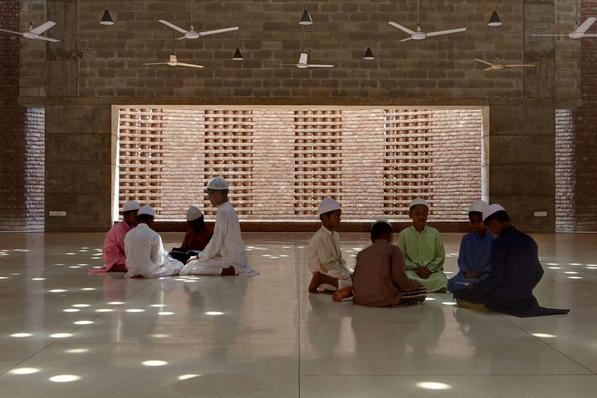 Boys attend a Quran lesson at the Bait Ur Rouf Mosque in Dhaka, Bangladesh, on April 23.