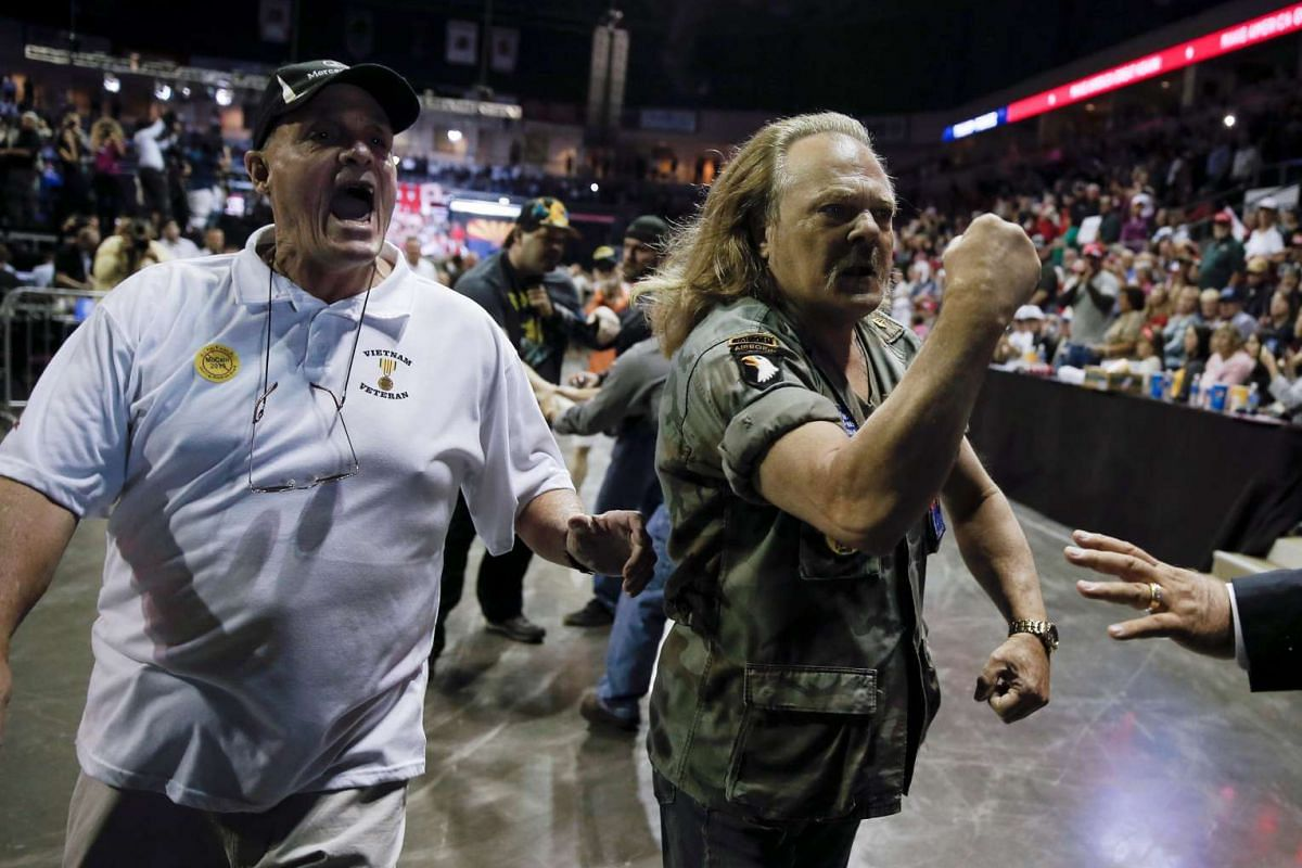 Supporters of Republican presidential nominee Donald Trump chase protesters out of a Trump campaign rally in Prescott Valley, Arizona, U.S., October 4, 2016. PHOTO: REUTERS