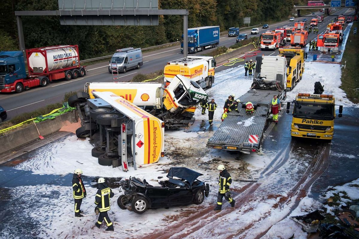 A tanker truck lies overturned on the motorway A4 near Cologne, Germany, October 4, 2016. A police spokesperson provided the information that the driver lost control over his vehicle and collided with another car. PHOTO: EPA