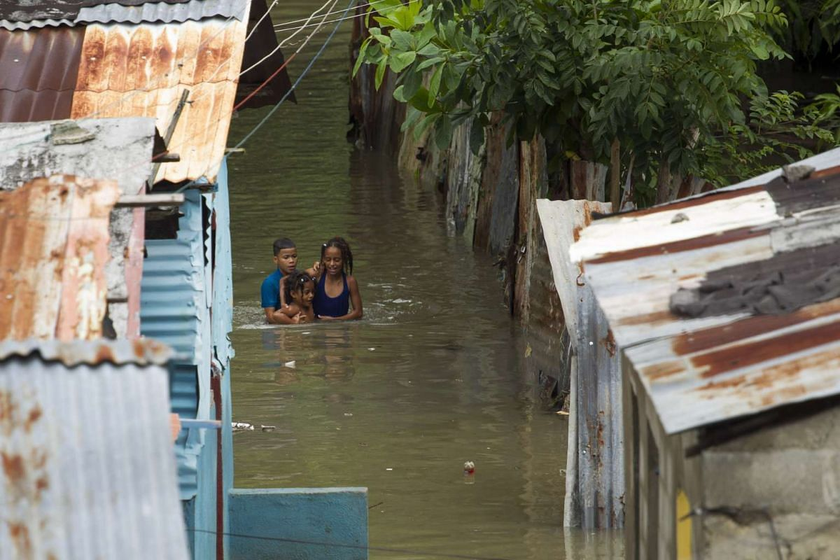 A flooded neighbourhood of La Puya in Santo Domingo on October 4, 2016 after Hurricane Matthew passed through Hispaniola -- the island that the Dominican Republic shares with Haiti. PHOTO: AFP