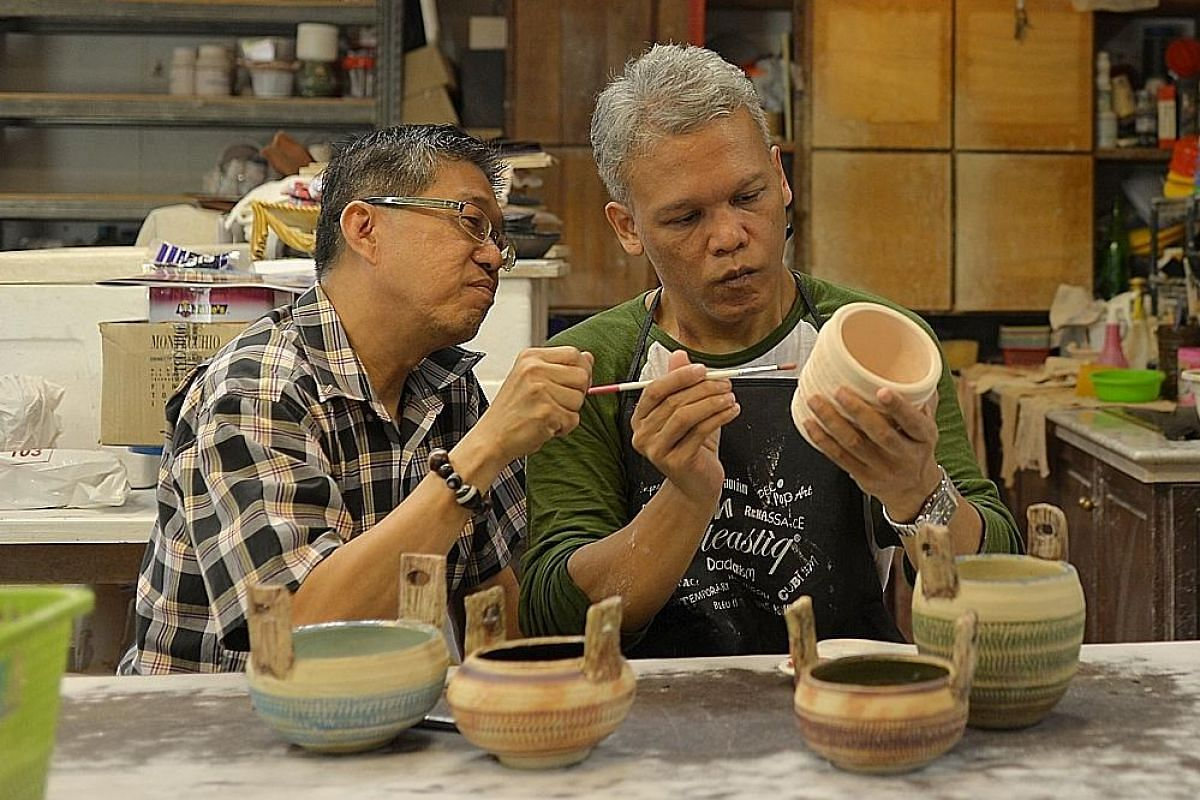 Mr Jumaat moulds a lump of clay on a potter's wheel at Boon's Pottery. He first took up pottery at the Institute of Mental Health as a form of therapy, and has become very good at it. Left: Mr Jumaat has breakfast with his 80-year-old mother in their