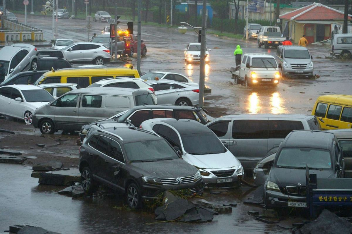Cars damaged by floodwaters caused by Typhoon Chaba in the southern island of Jeju on Oct 5, 2016.