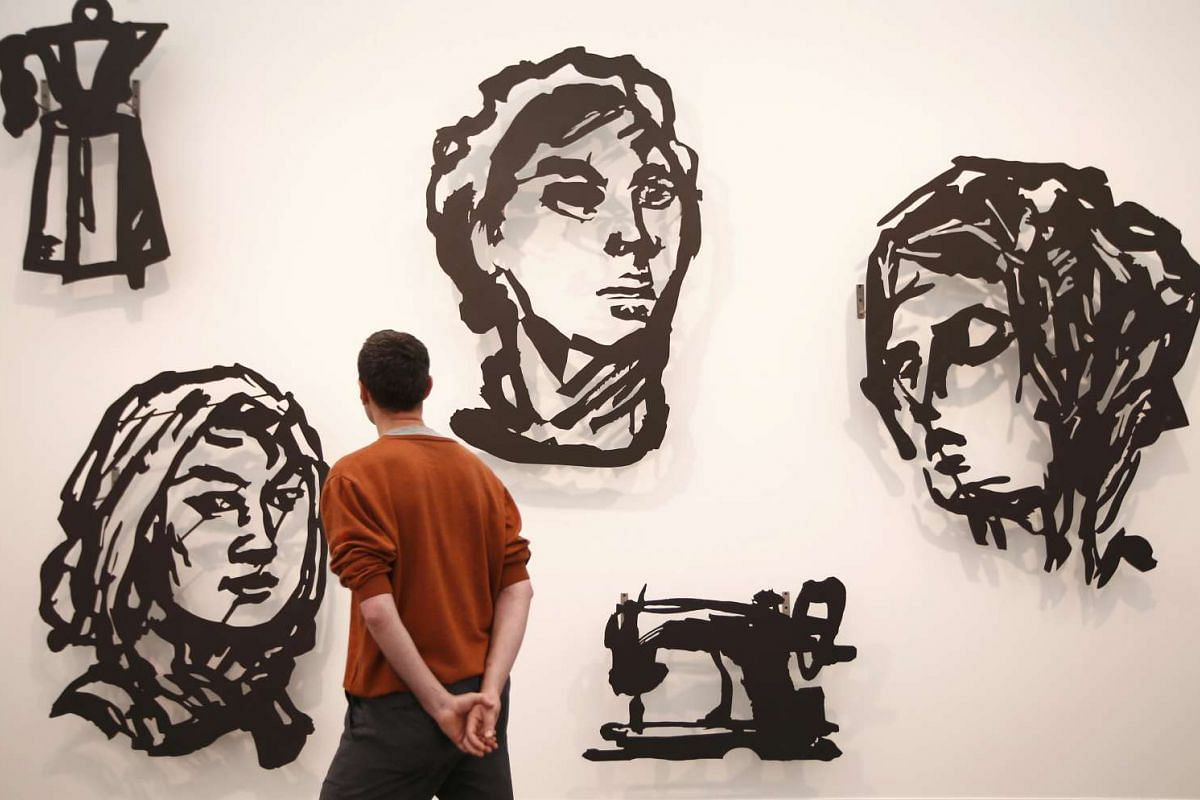Silhouettes by the artist William Kentridge are seen at the London Frieze Art Fair in London, Britain October 6, 2016. PHOTO: REUTERS