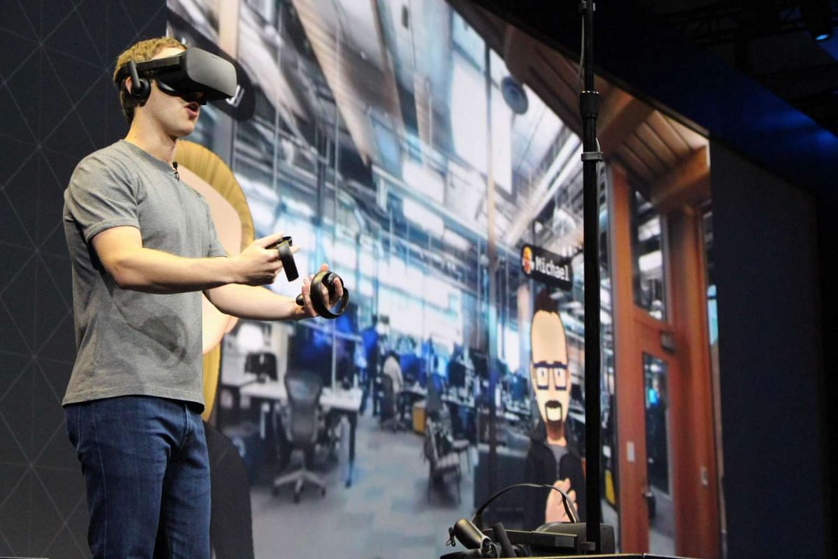 Facebook co-founder and chief executive, Mark Zuckerberg, speaks at an Oculus developers conference while wearing a virtual reality headset in San Jose, California on October 6, 2016. PHOTO: AFP