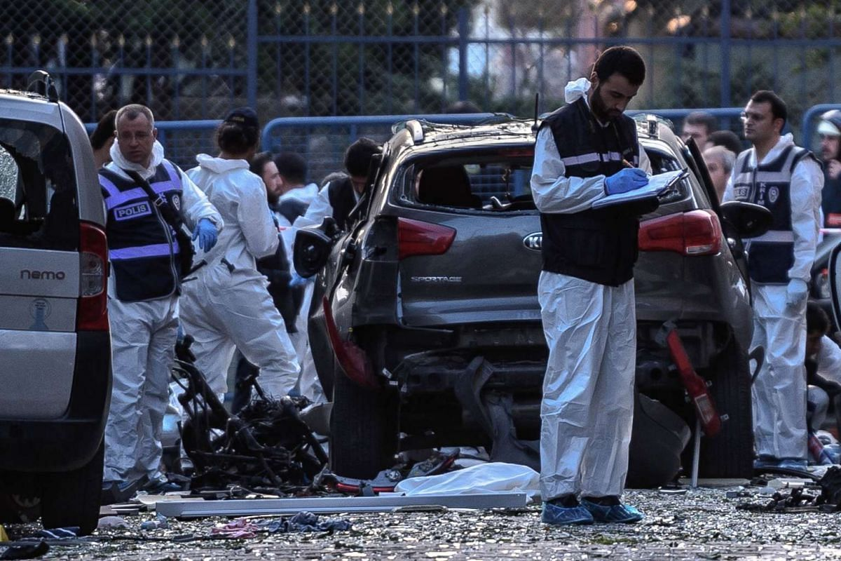 Forensic officers work next to a damaged motorbike at the scene of a blast near a police station in Istanbul, Turkey on October 6, 2016. PHOTO: AFP