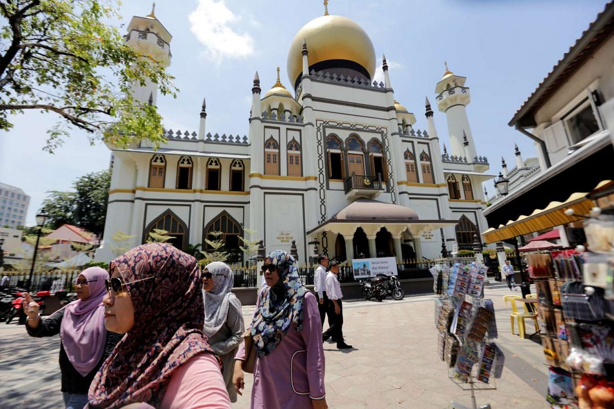 The onion domes and minarets topping the Sultan Mosque in Kampong Glam have undergone various colour changes through the years.